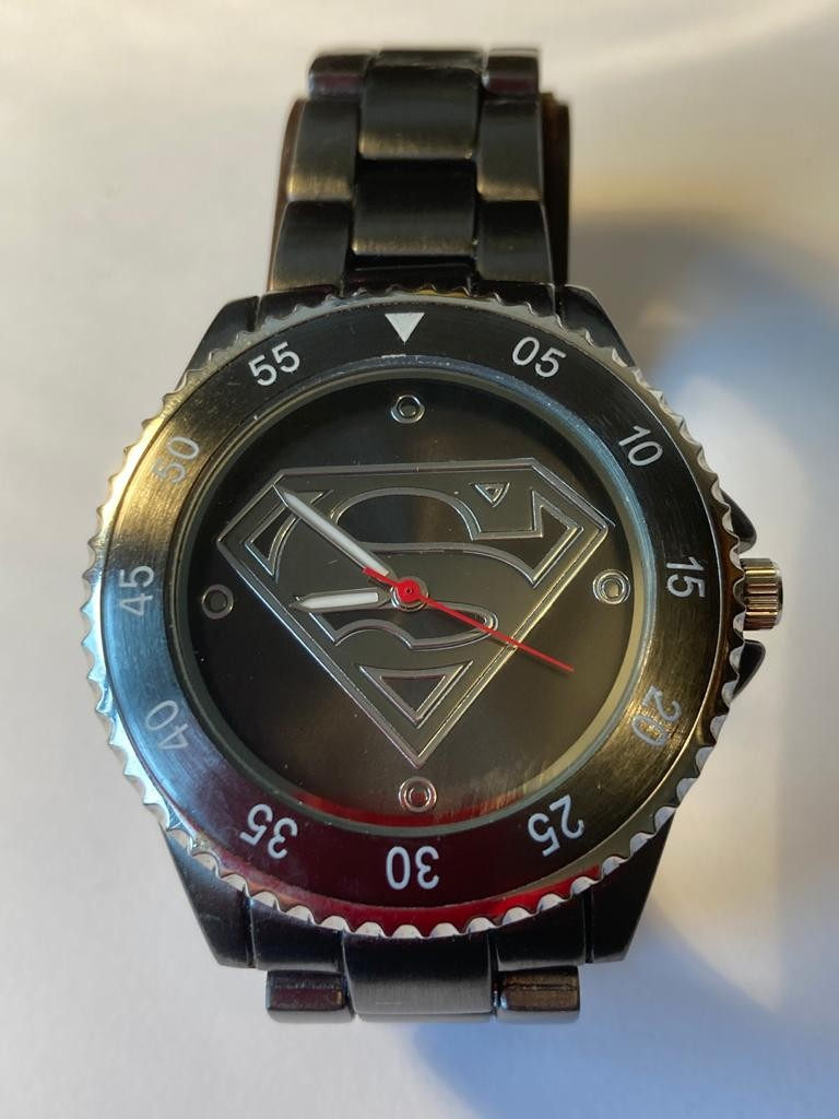 Accutime Superman gents wristwatch .Finished in silver and black with gunmetal grey brushed steel