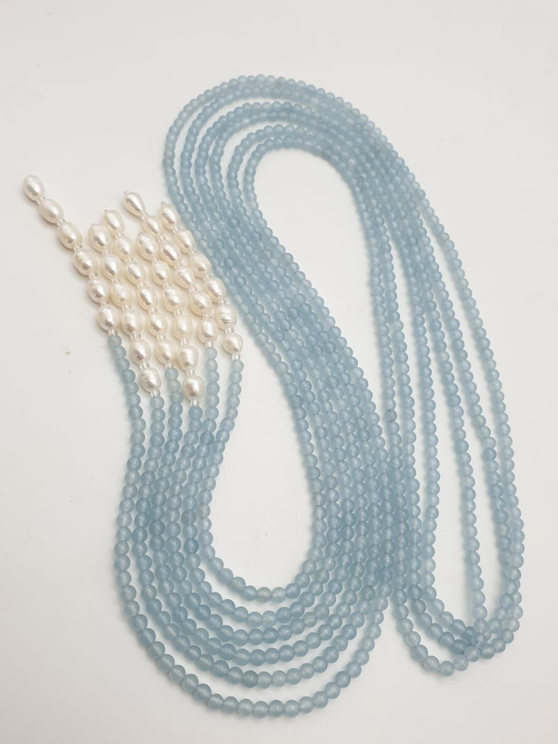 Three very long rows (128cm!) of aquamarine (colour enhanced) and natural pearls that can form a - Image 3 of 10