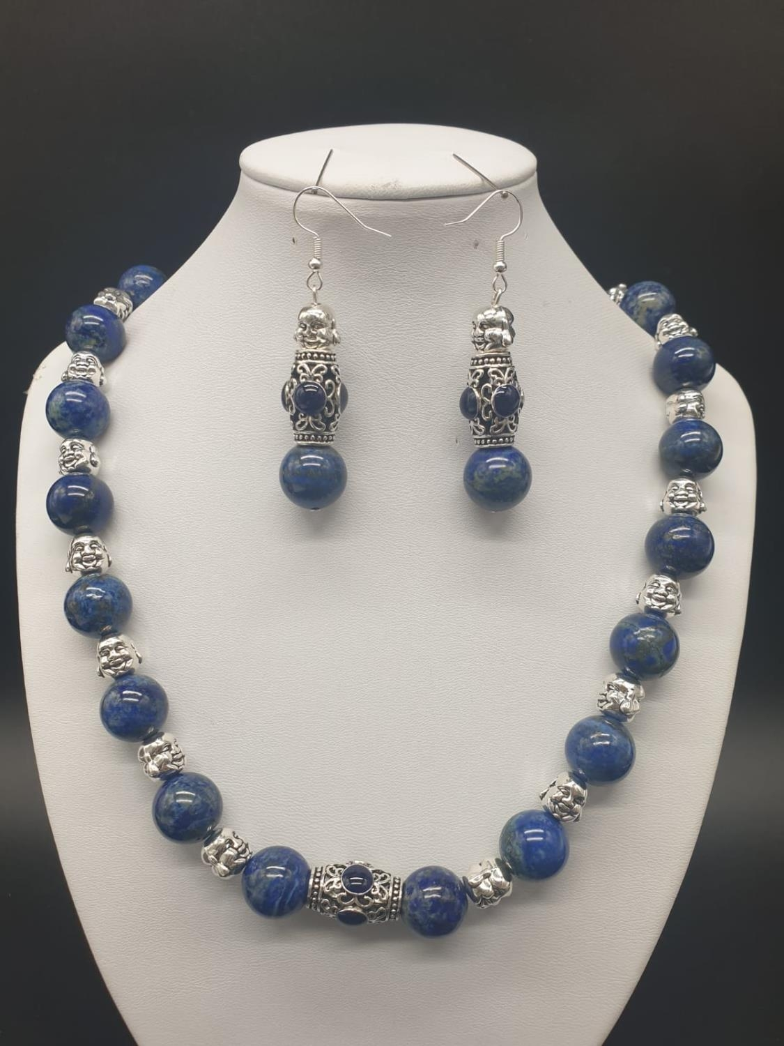 A Tibetan Buddhist lapis lazuli necklace and earrings set in a presentation box. Necklace length: