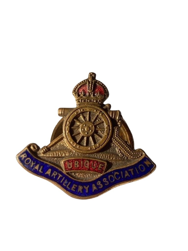 Vintage Royal artillery Association lapel badge in brass ,with contrasting red and blue enamel work.