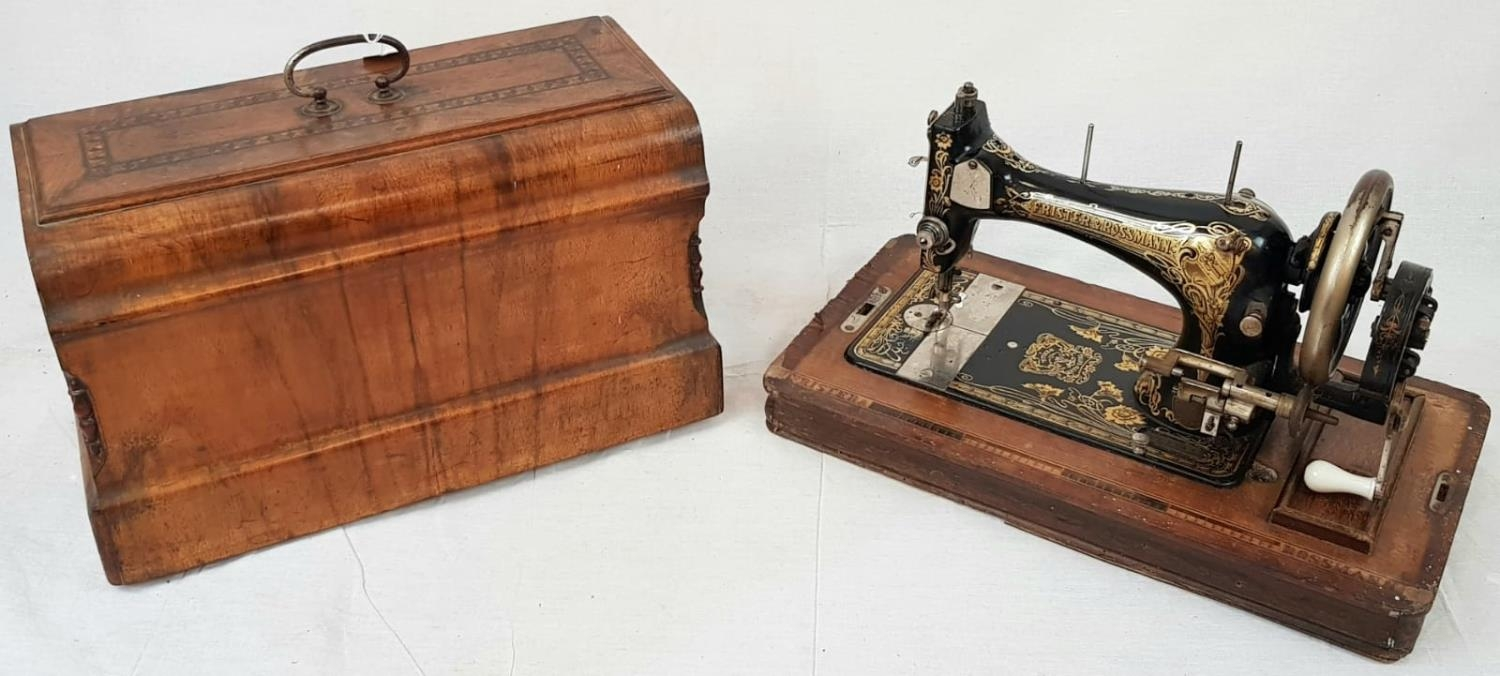 A FINELY DECORATED ANTIQUE SEWING MACHINE IN WOODEN CARRYING CASE MADE BY FRISTER AND ROSSMAN CICA
