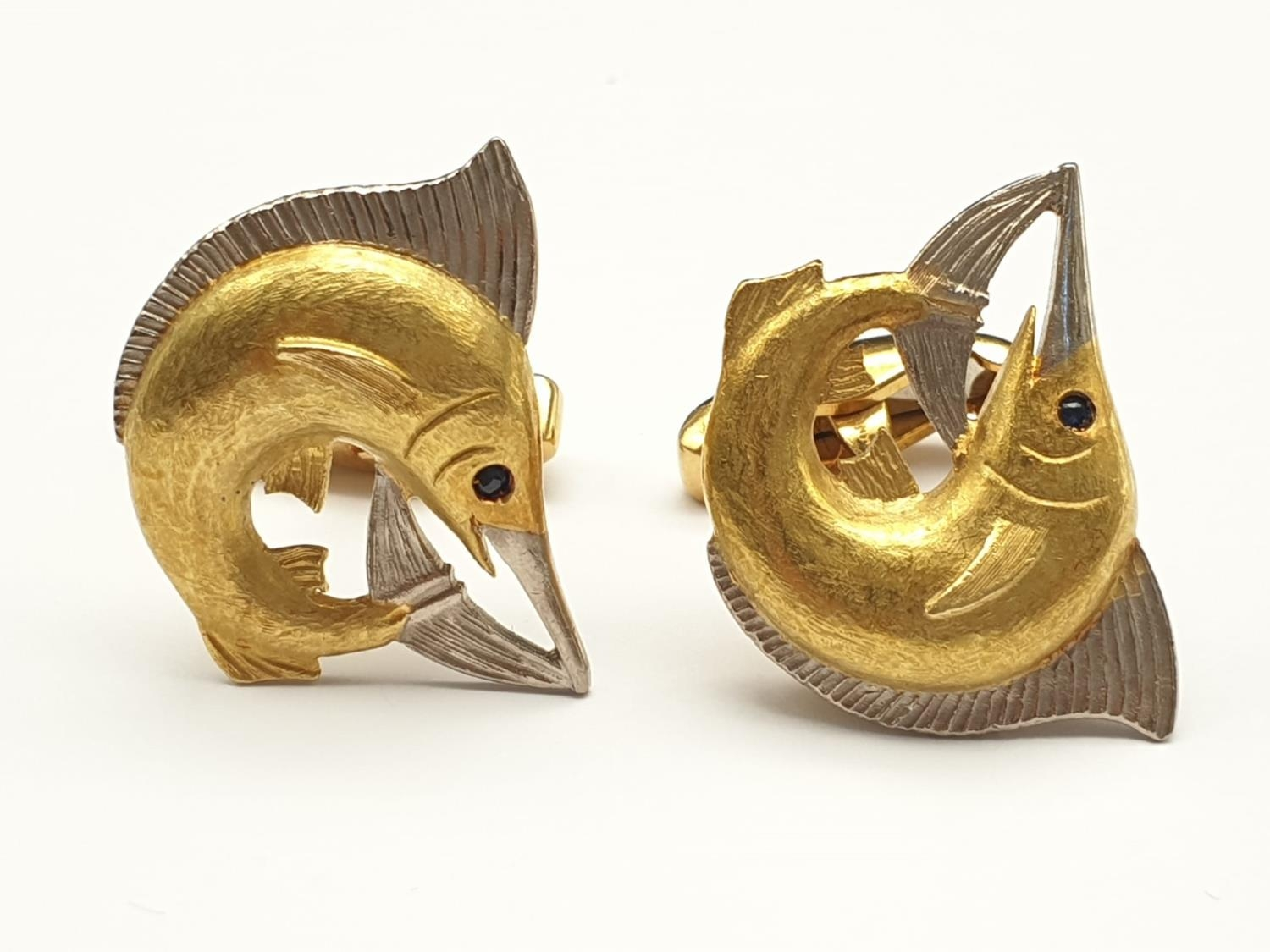 Exquisite Pair of Hand-Made 18K White and Yellow Gold Sailfish Cufflinks with Sapphire Stone Eyes.