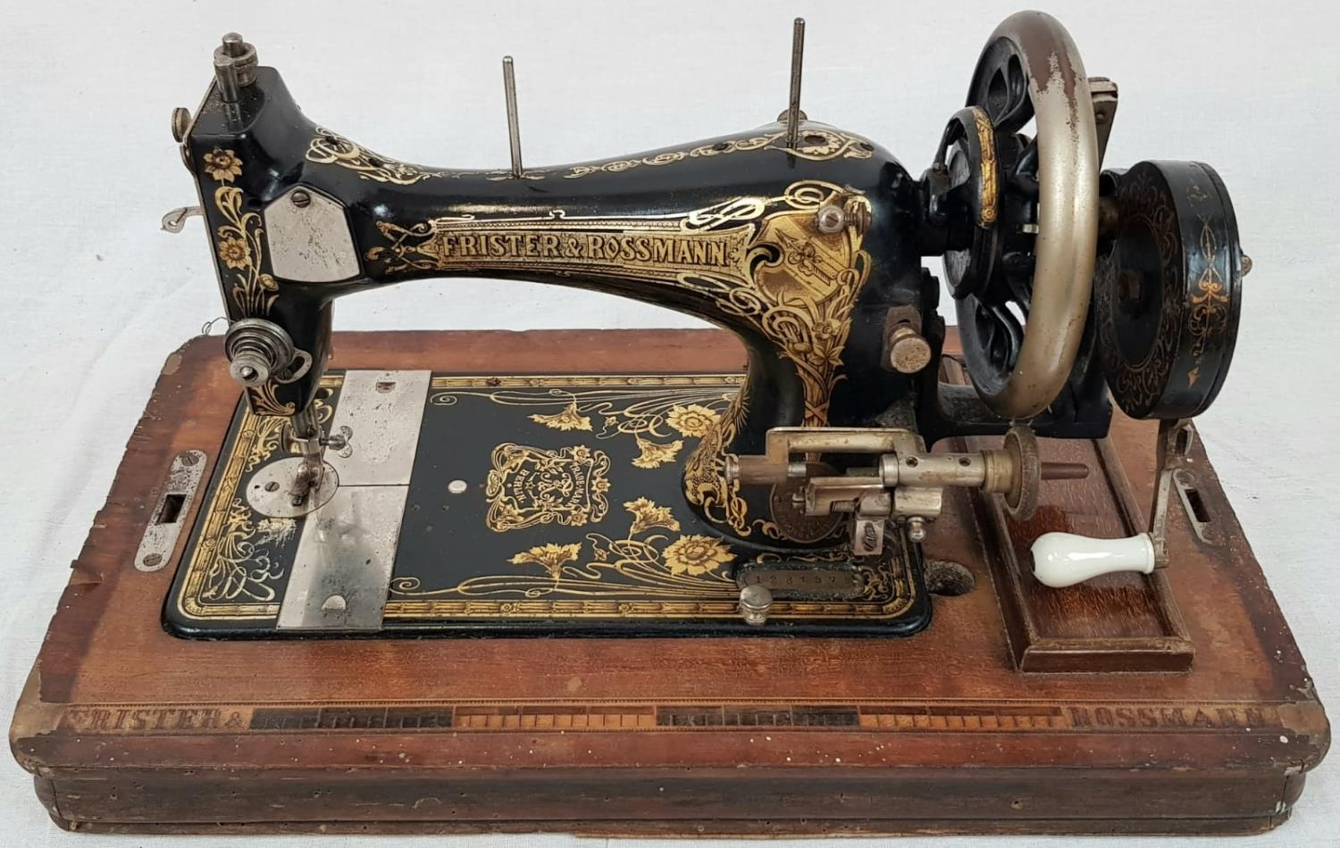 A FINELY DECORATED ANTIQUE SEWING MACHINE IN WOODEN CARRYING CASE MADE BY FRISTER AND ROSSMAN CICA - Image 2 of 5