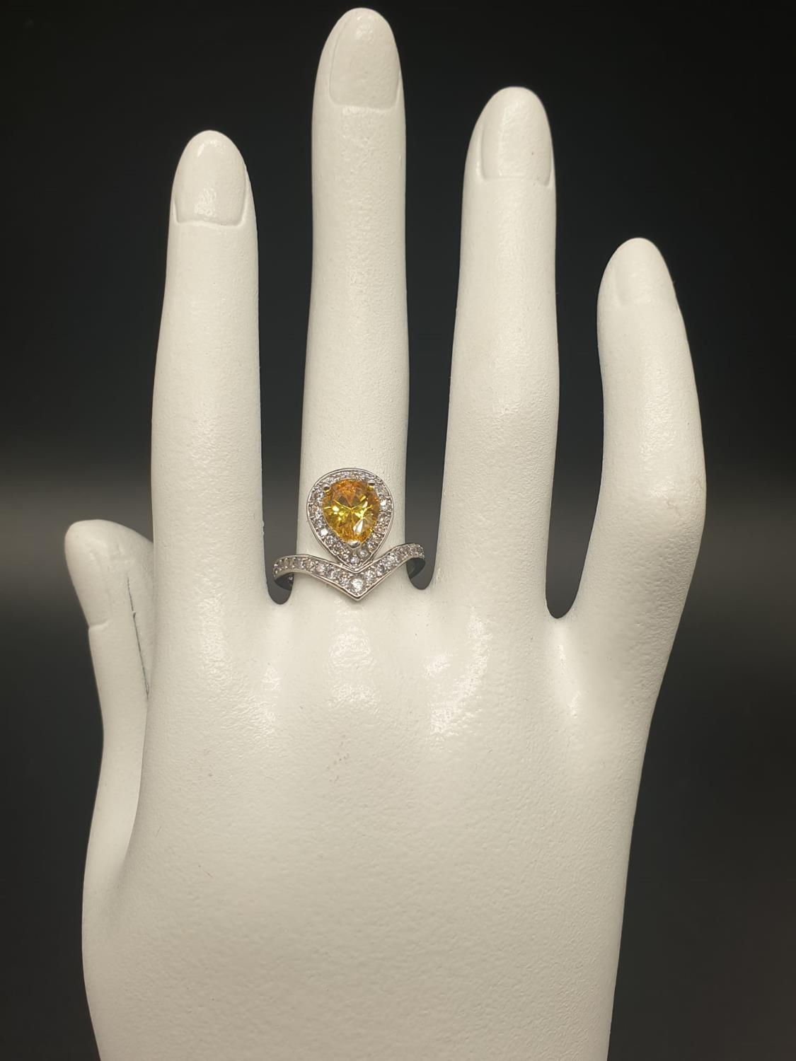 A white metal ring and earrings set with yellow topaz and clear sapphires. Ring size: N. Presented - Image 7 of 12