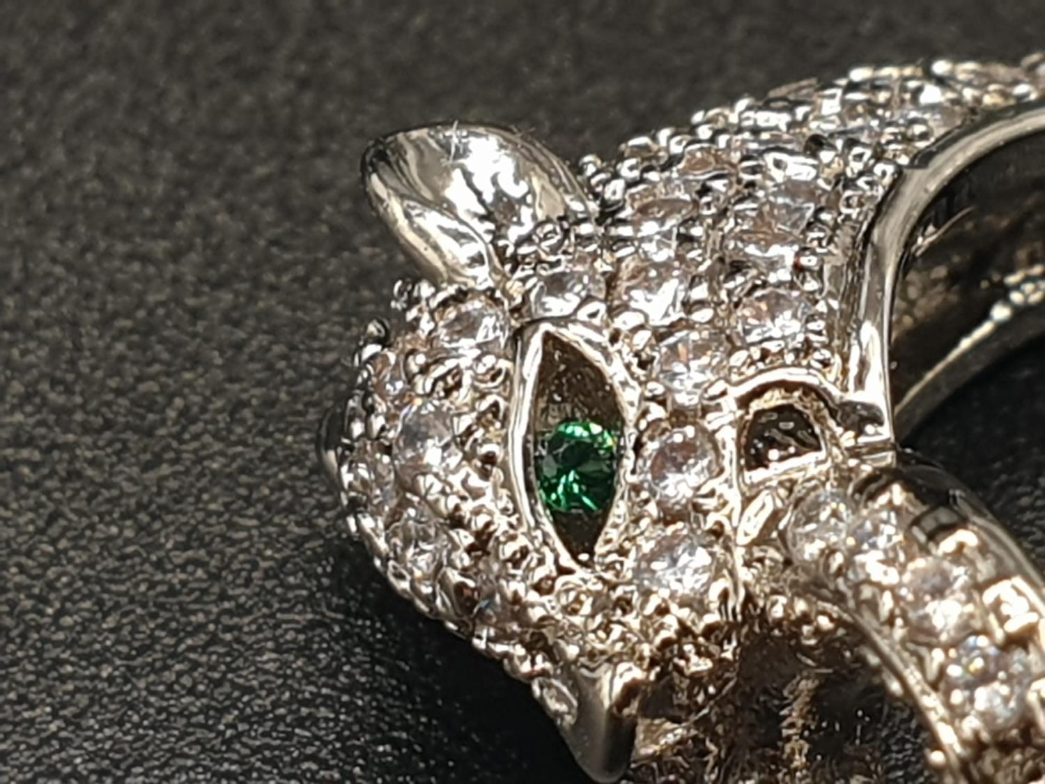 A white metal (untested) Cartier Panther style bracelet and earrings set In a presentation box. Ring - Image 14 of 15