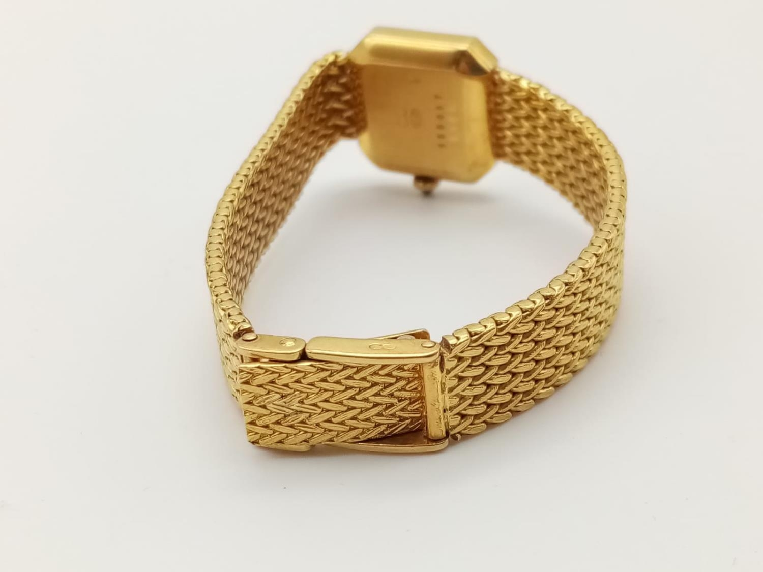 18K GOLD DRESS WATCH BY CHOPARD OF GENEVA WITH DIAMOND BEZEL AND SOLID GOLD STRAP. 20MM - Image 5 of 9