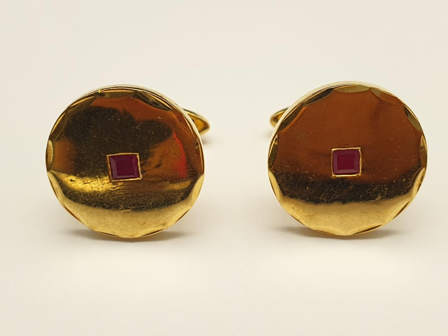 A Pair of 14k Yellow Gold and Ruby Cufflinks. 11.83g