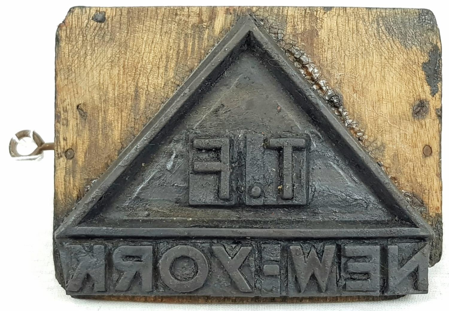 """AN ANTIQUE FREIGHT BOX STAMP WITH """"T.F NEW YORK"""" ON IT. 10 X 14cms"""