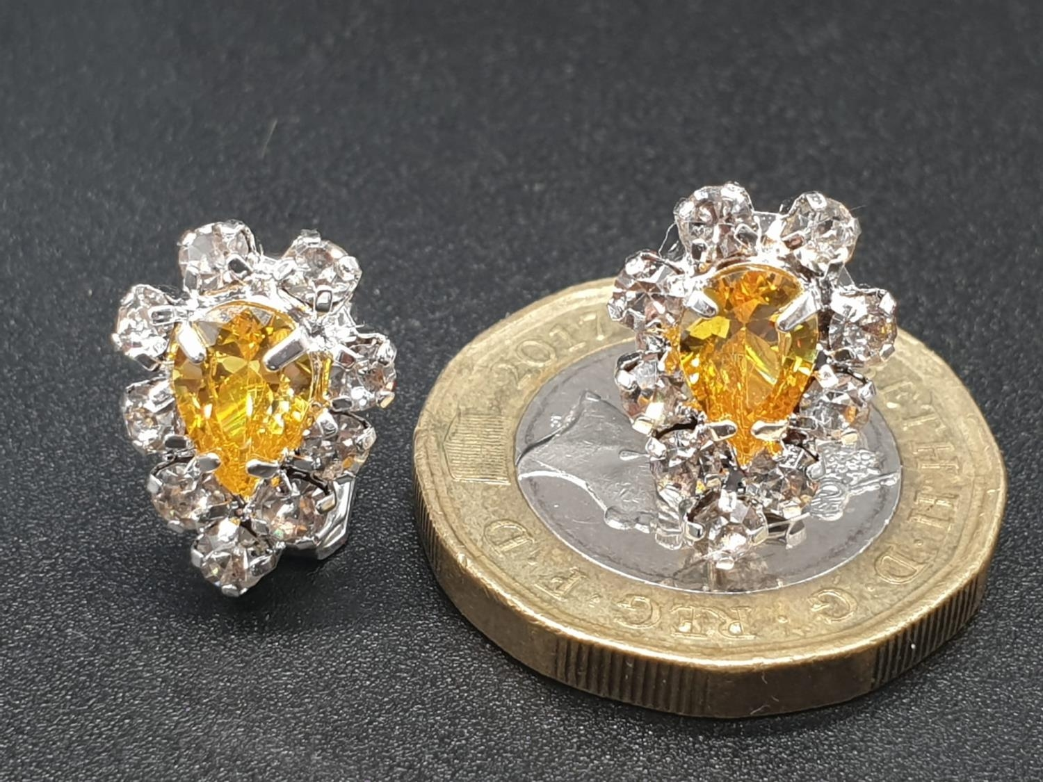 A white metal ring and earrings set with yellow topaz and clear sapphires. Ring size: N. Presented - Image 11 of 12