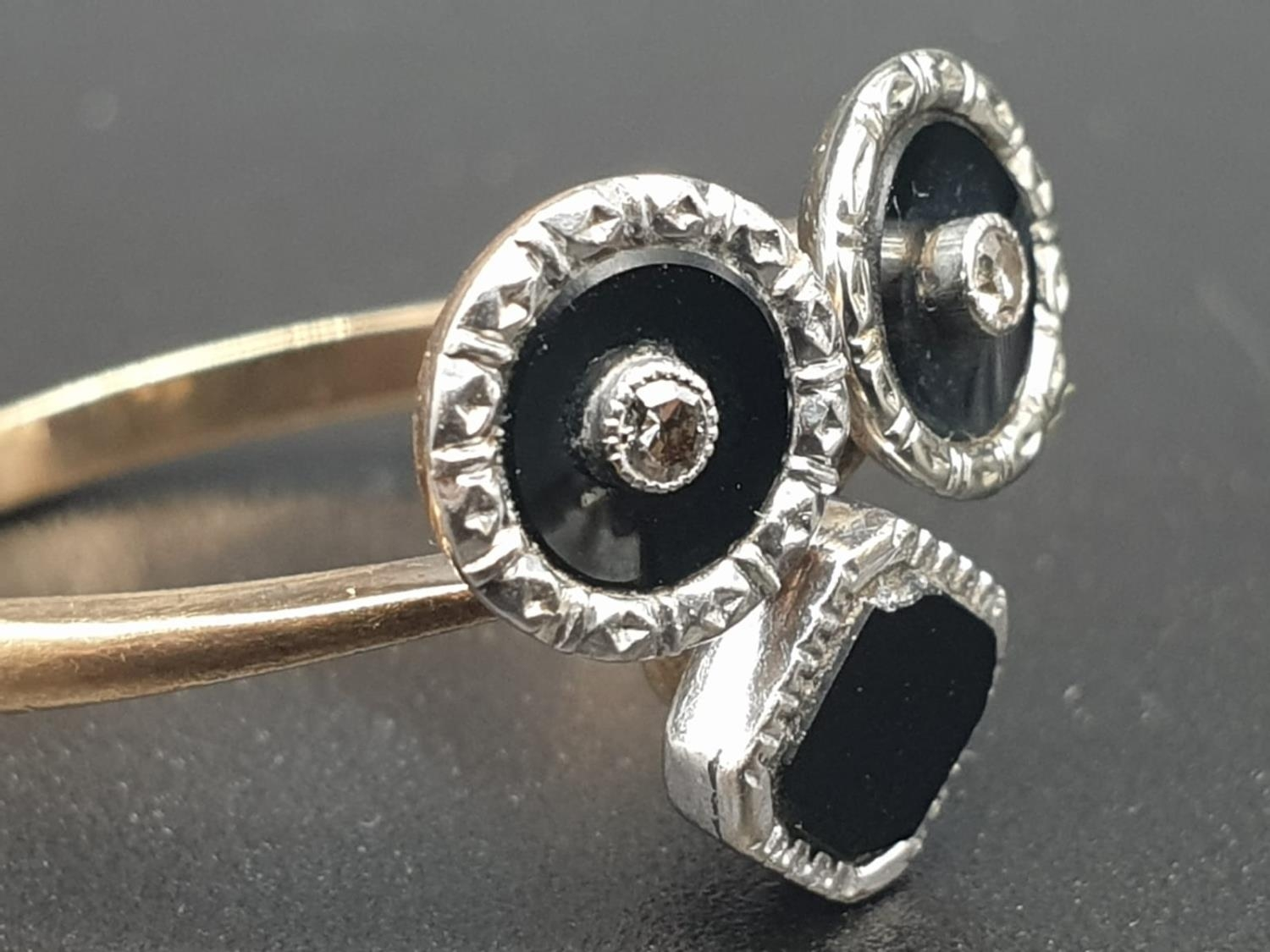 A 9K GOLD RING WITH BLACK ENAMEL AND DIAMONDS USED TO FORM THE SHAPE OF A FACE. 3.3gms size O - Image 2 of 6