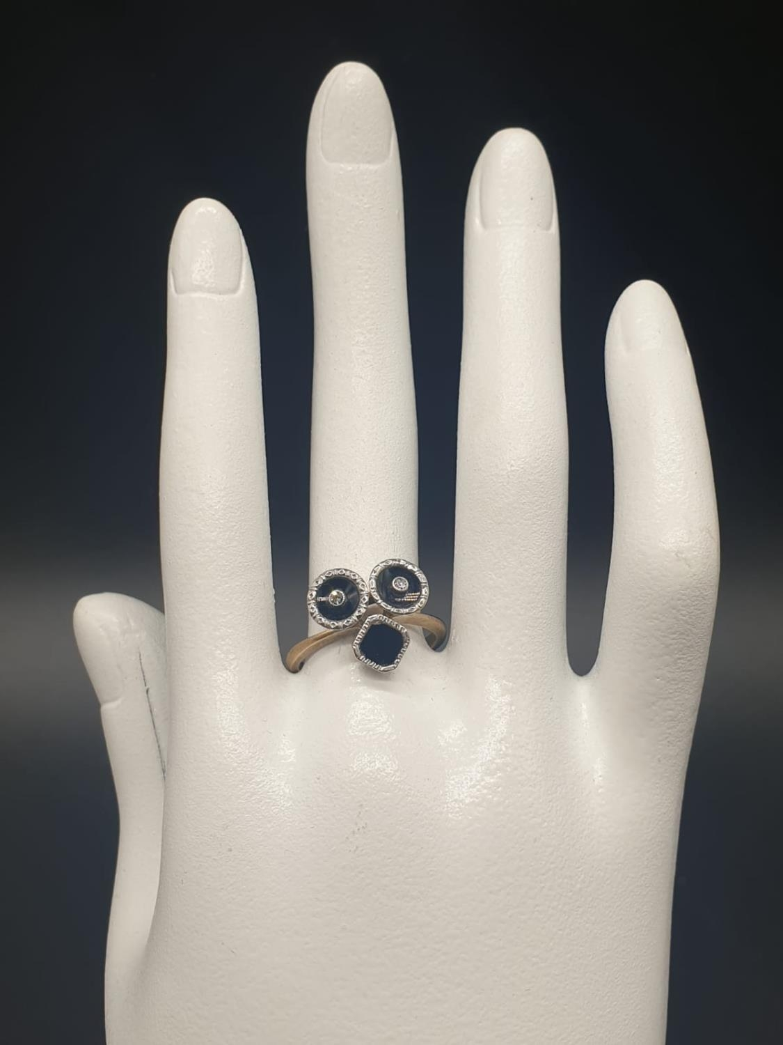 A 9K GOLD RING WITH BLACK ENAMEL AND DIAMONDS USED TO FORM THE SHAPE OF A FACE. 3.3gms size O - Image 6 of 6