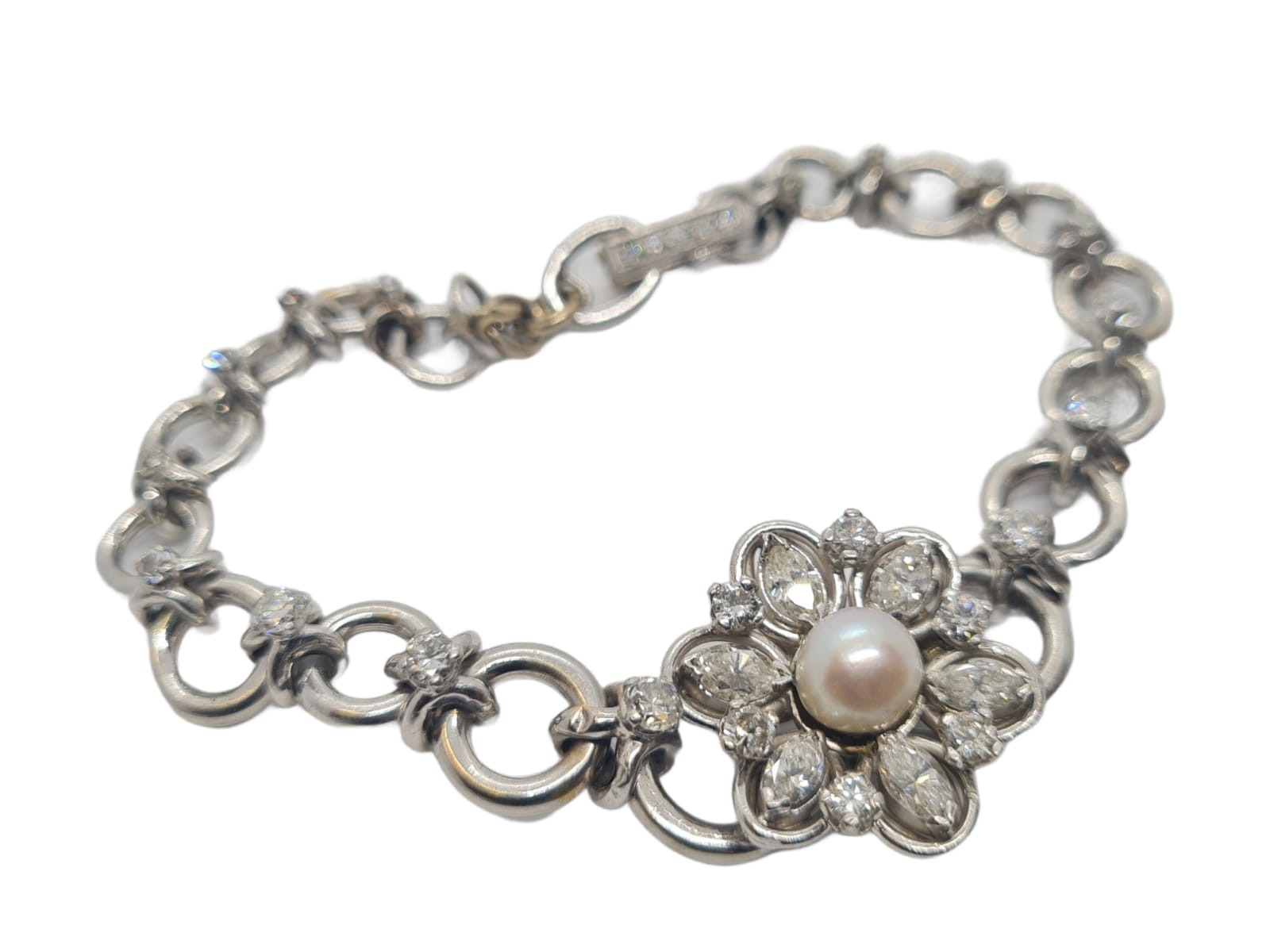 18k white gold French antique diamond and pearl set bracelet, flower design, weight 18.5g approx 2ct