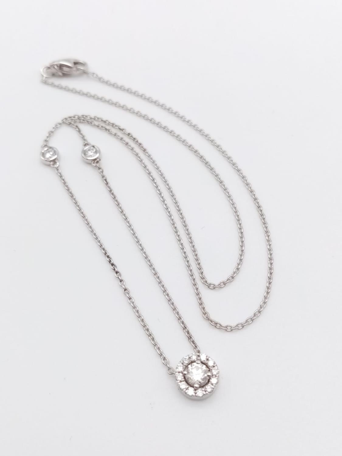 An elegant 14k white gold diamond necklace, weight 2.5g and approx 0.50ct diamonds chain 43cm long