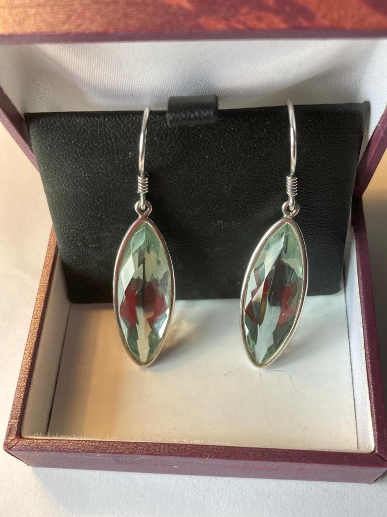 Pair of silver drop earrings ,having large marquise Aqua coloured faceted stones .925 silver.