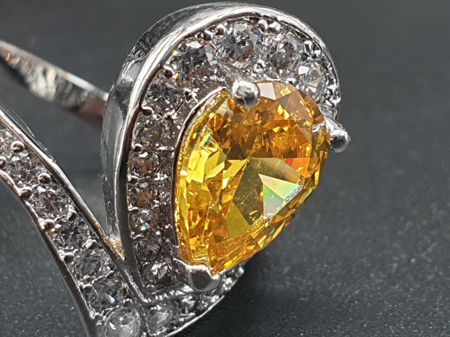 A white metal ring and earrings set with yellow topaz and clear sapphires. Ring size: N. Presented - Image 3 of 12
