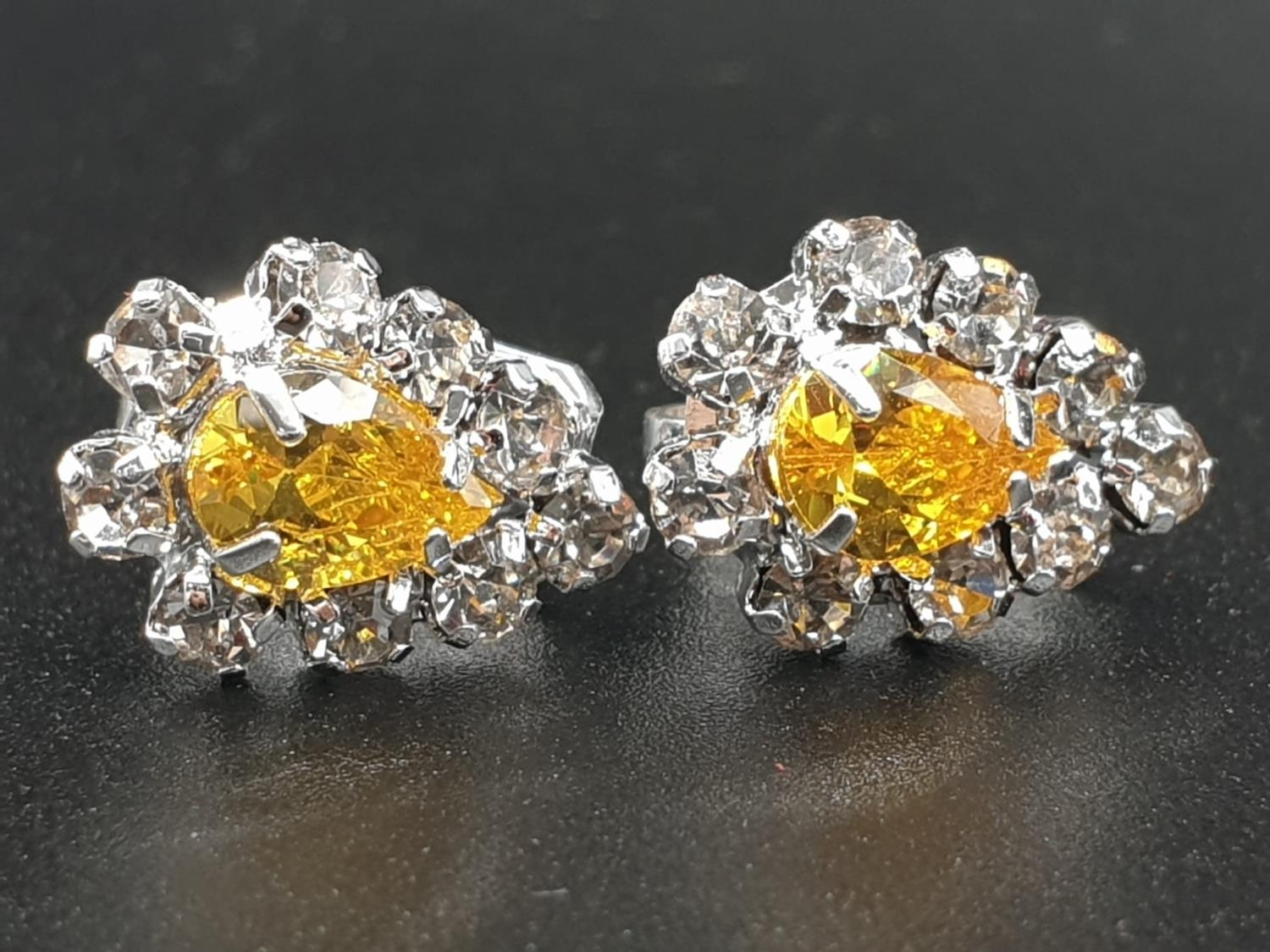 A white metal ring and earrings set with yellow topaz and clear sapphires. Ring size: N. Presented - Image 8 of 12
