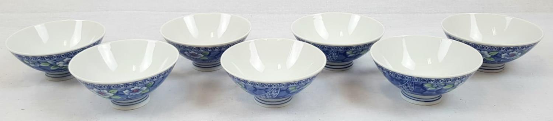 Seven Vintage Decorated Rice Bowls. Signed on base. Floral decoration. 12cm diameter