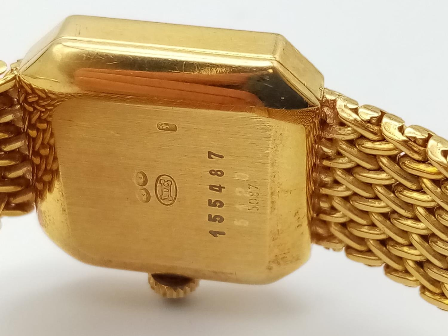 18K GOLD DRESS WATCH BY CHOPARD OF GENEVA WITH DIAMOND BEZEL AND SOLID GOLD STRAP. 20MM - Image 6 of 9