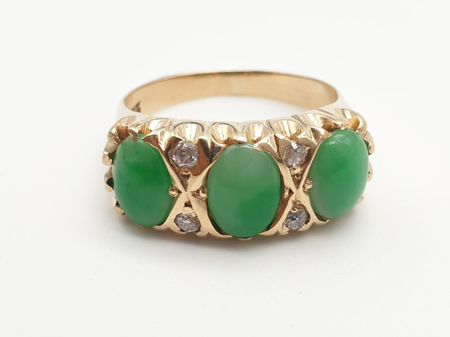 14k yellow gold antique ring with trilogy green jadeite and decorated with diamonds, weight 8.6g and