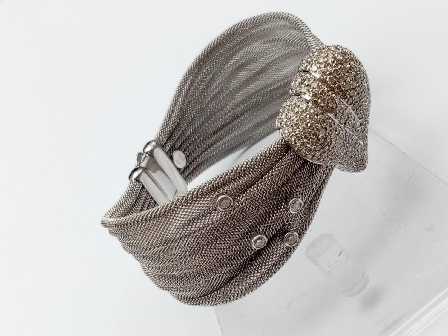 an 18k white gold bracelet with 10 diamonds and a diamond encrusted heart. 53.4gms 19cms - Image 6 of 10