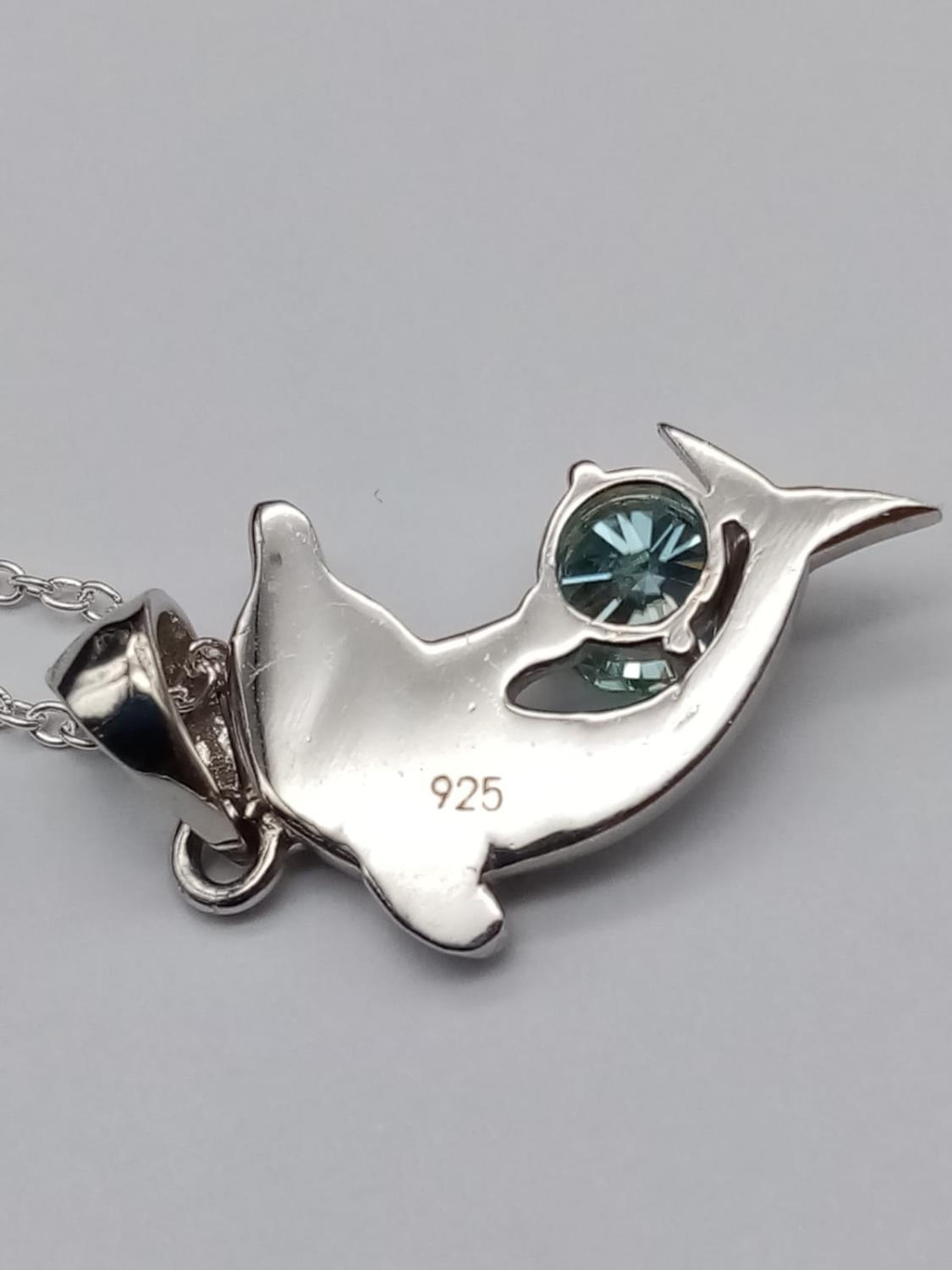 A matching set of moissanite gemstone jewellery including a 0.7ct dolphin pendant and a 0.3ct blue - Image 8 of 9