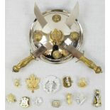 Twelve military cap and collar badges and Indian shield display Plaque