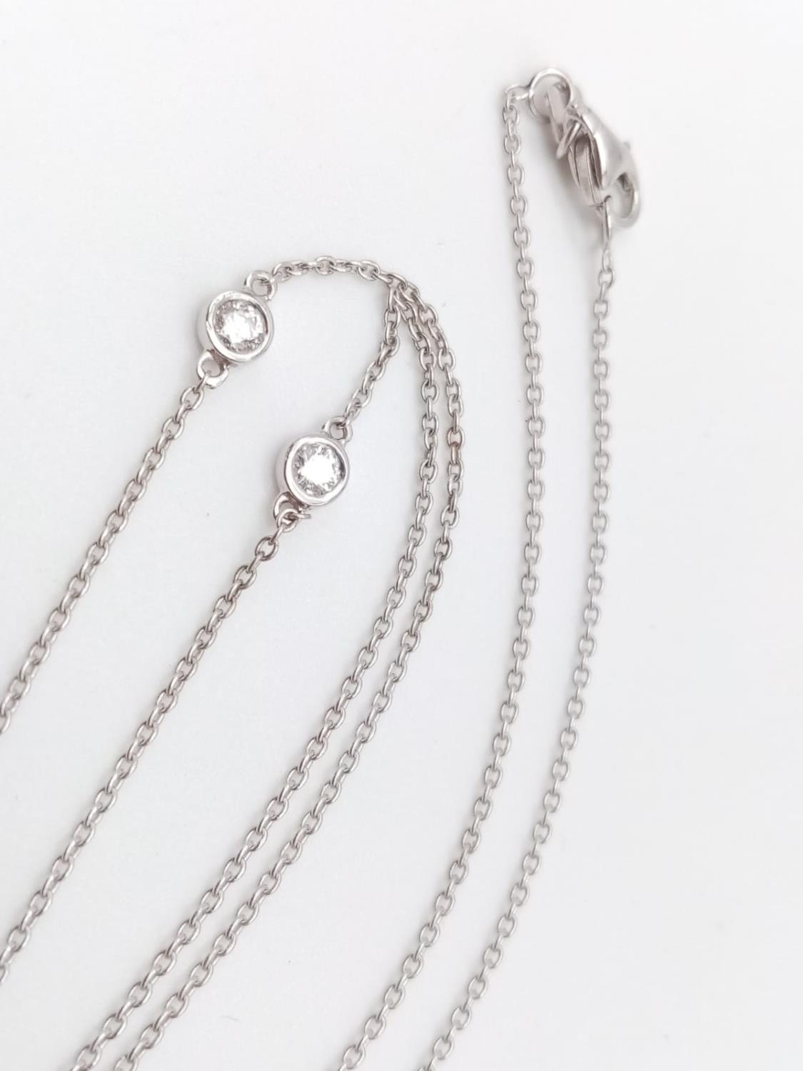 An elegant 14k white gold diamond necklace, weight 2.5g and approx 0.50ct diamonds chain 43cm long - Image 3 of 5