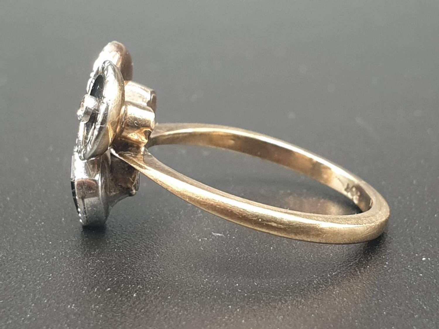A 9K GOLD RING WITH BLACK ENAMEL AND DIAMONDS USED TO FORM THE SHAPE OF A FACE. 3.3gms size O - Image 3 of 6