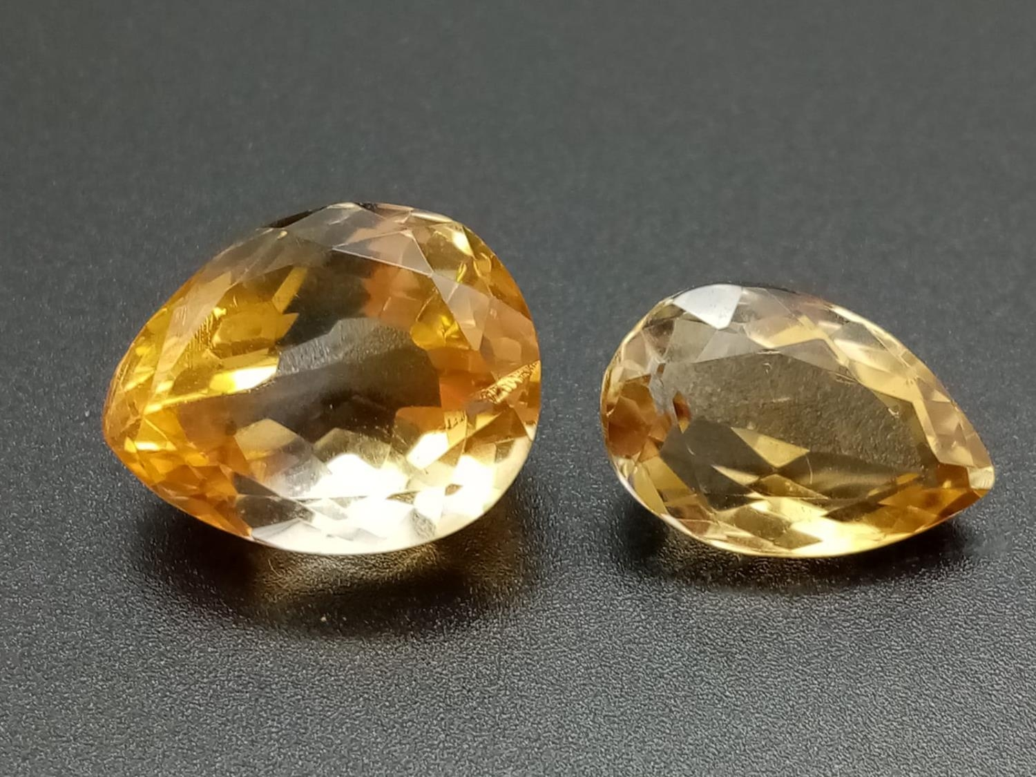 Two large golden citrines pear cut total carats 32.45