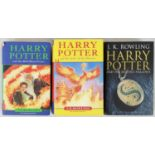 Three Harry Potter first Editions including the rare Harry Potter and the Half Blood Prince with the