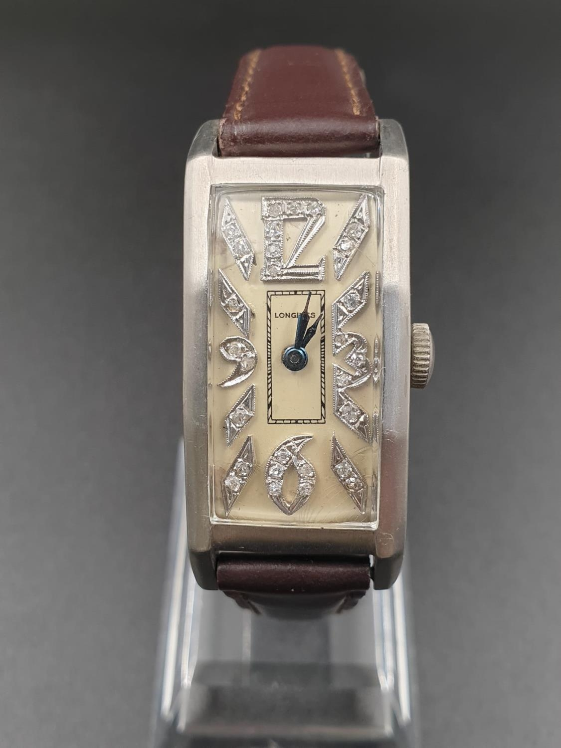 A PLATINUM LONGINES WRIST WATCH WITH DIAMOND NUMBERS. 20mm manual movement.