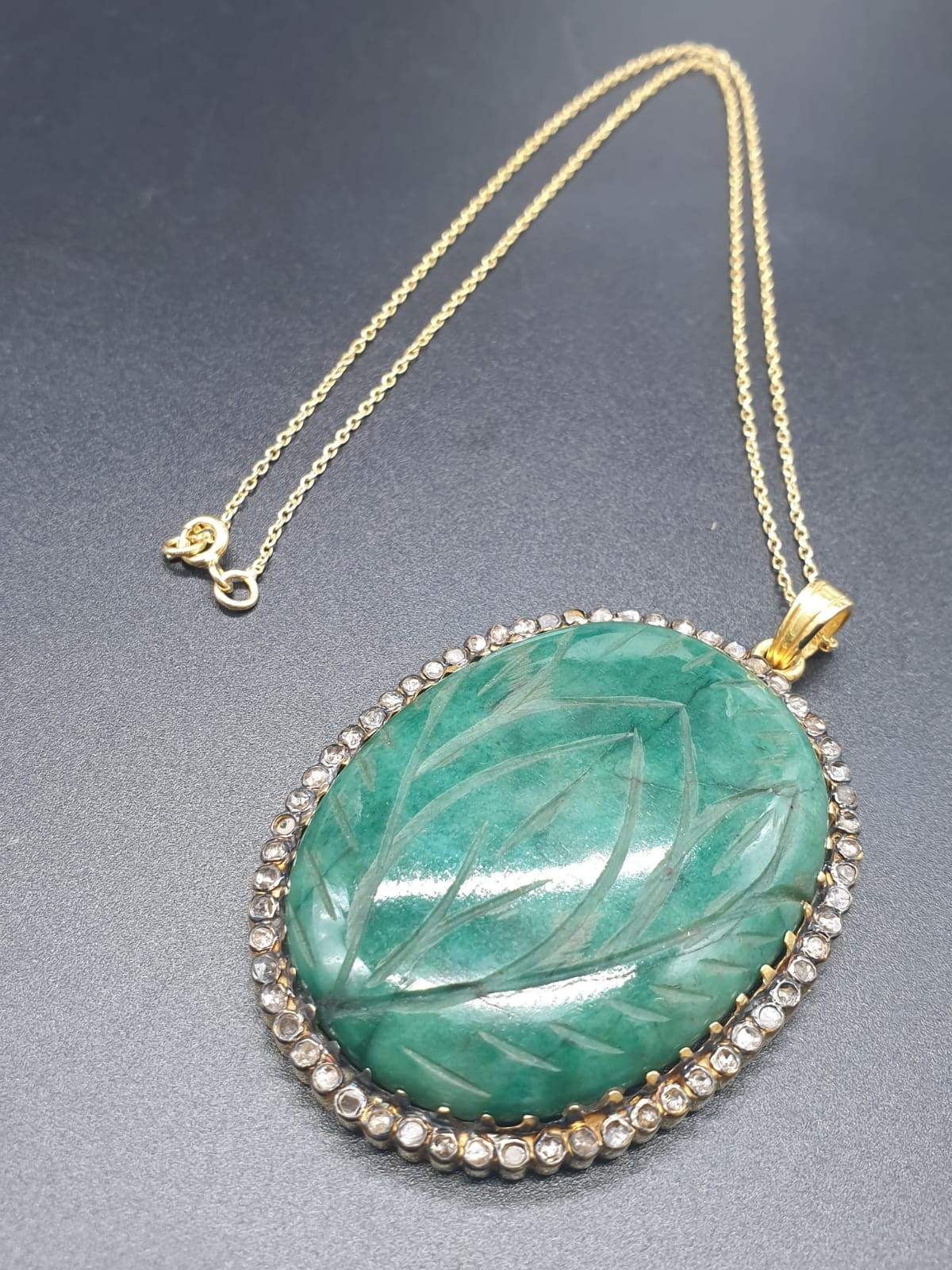A carved emerald Pendant with a halo of rose cut diamonds in pave setting in sterling silver with - Image 2 of 7