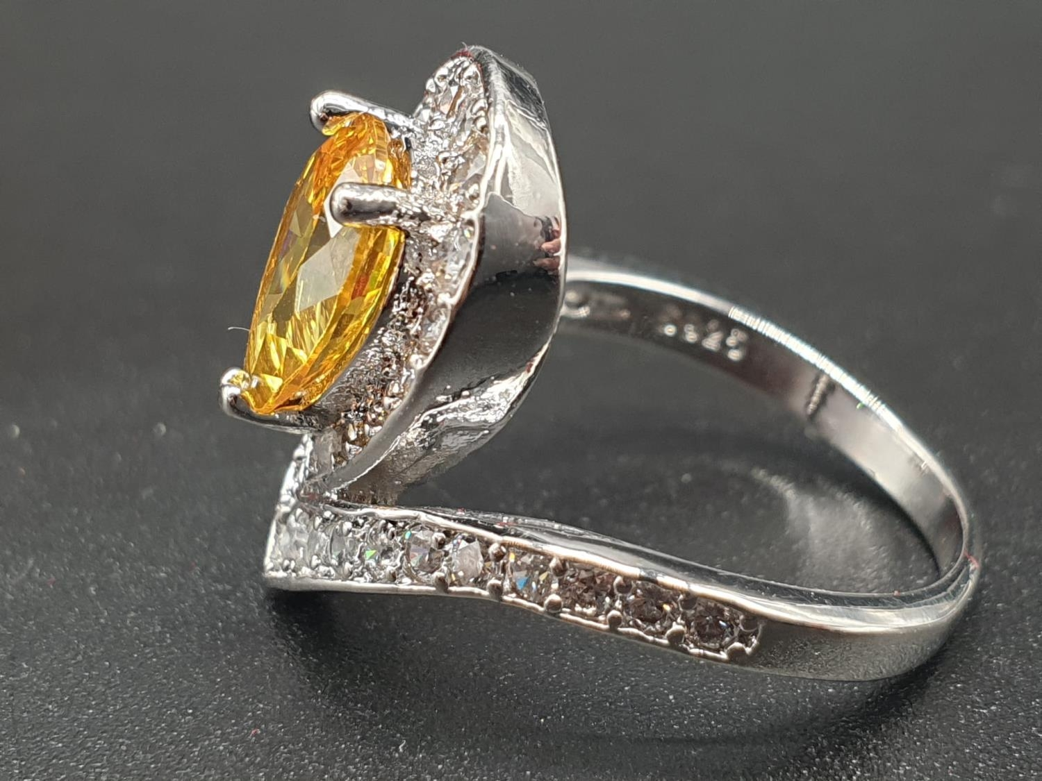 A white metal ring and earrings set with yellow topaz and clear sapphires. Ring size: N. Presented - Image 4 of 12