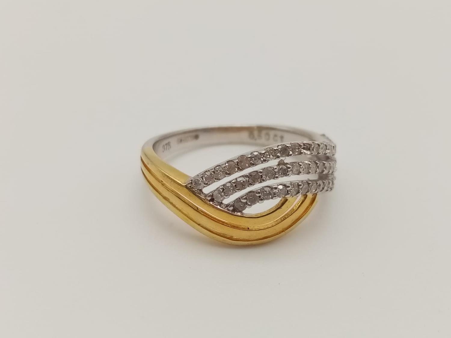 9k yellow and white gold diamond set ring with 0.50ct diamonds, weight 3.2g and size P