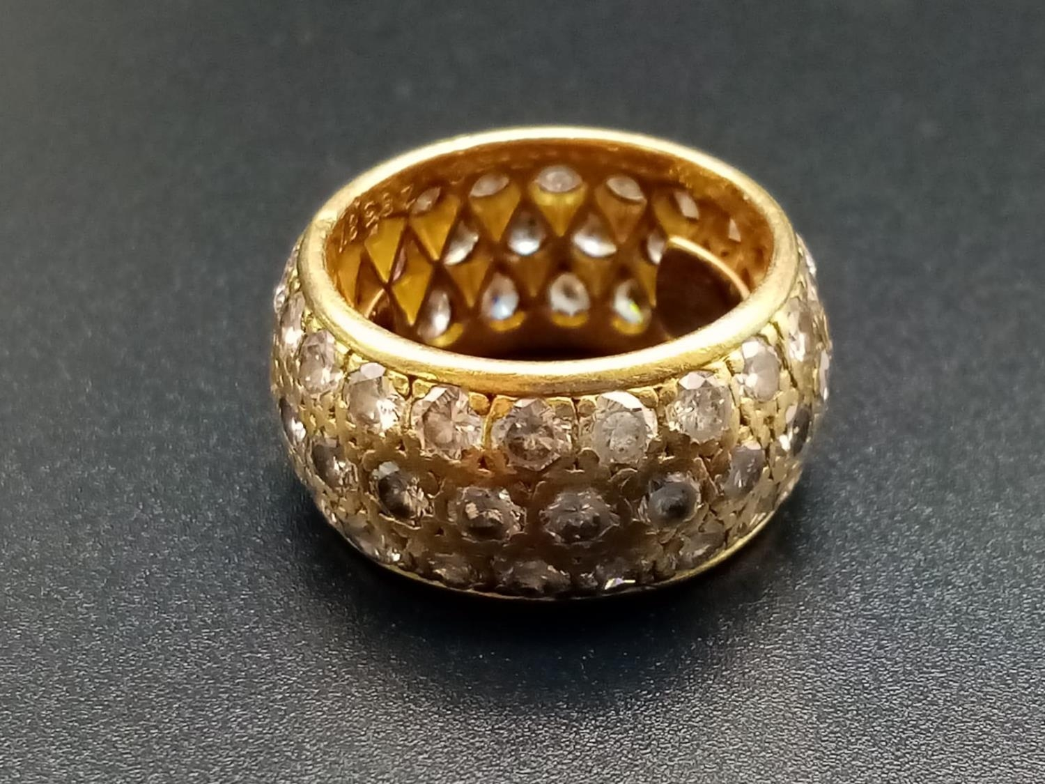 AN 18K ROSE GOLD BAND RING ENCRUSTED WITH DIAMOND STONES (APPROX 4CT) 10.3gms size k/l