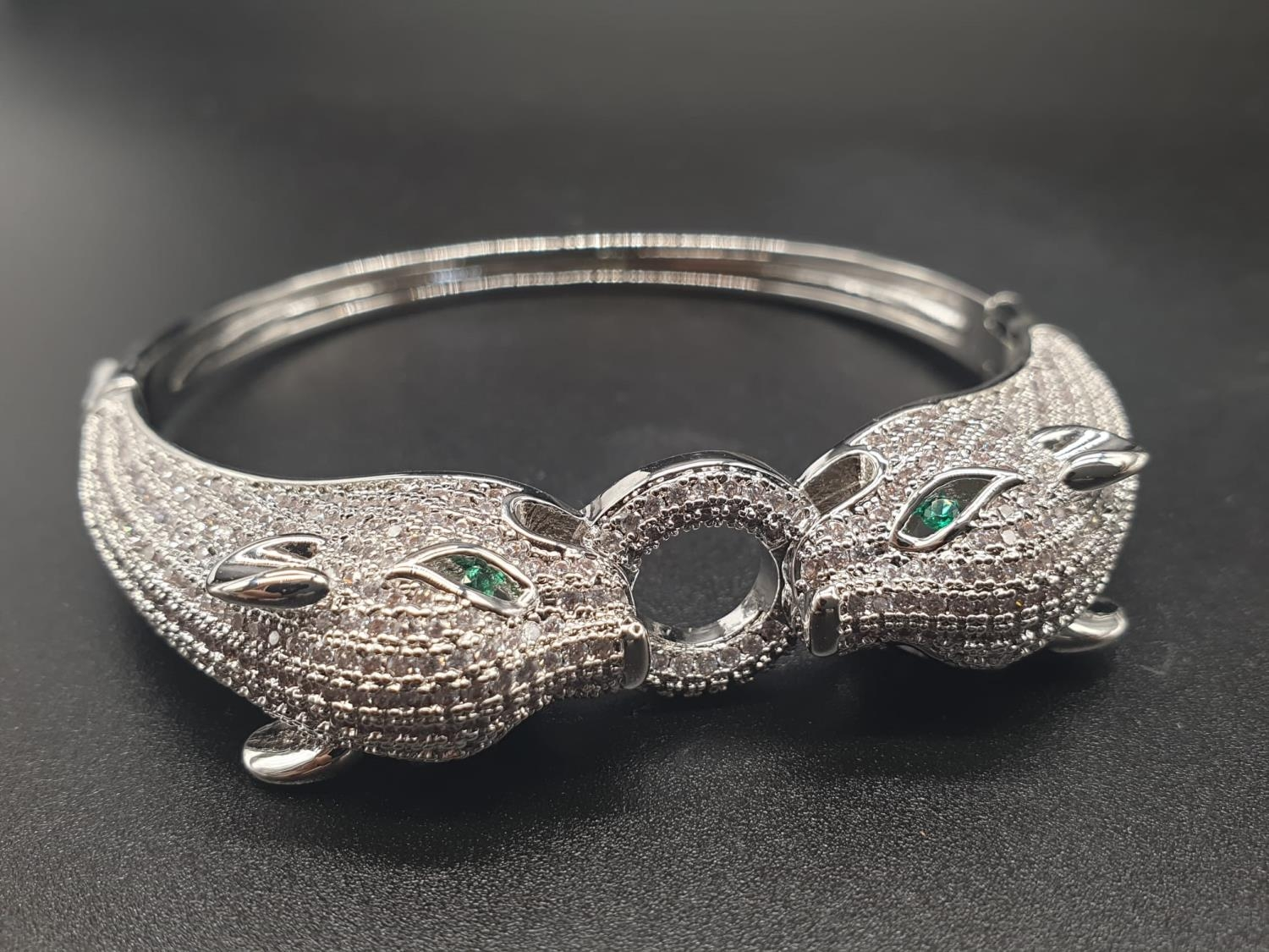 A white metal (untested) Cartier Panther style bracelet and earrings set In a presentation box. Ring - Image 2 of 15