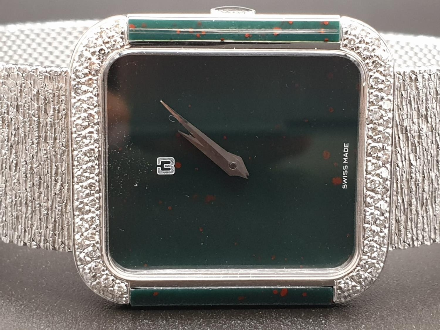AN 18K WHITE GOLD DRESS WATCH WITH HALF DIAMOND BEZEL AND SOLID GOLD STRAP. 26MM - Image 5 of 12