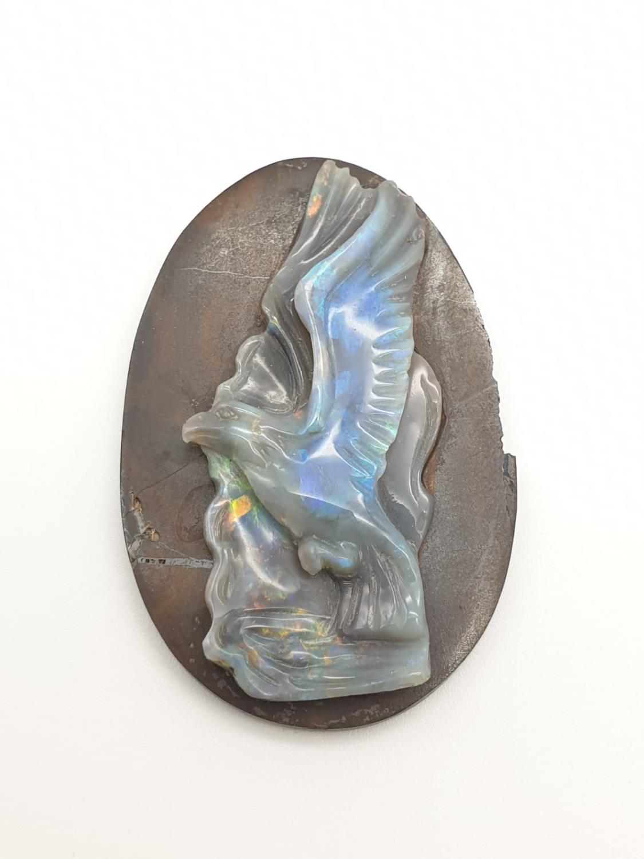 Opal hand carved eagle on natural rock