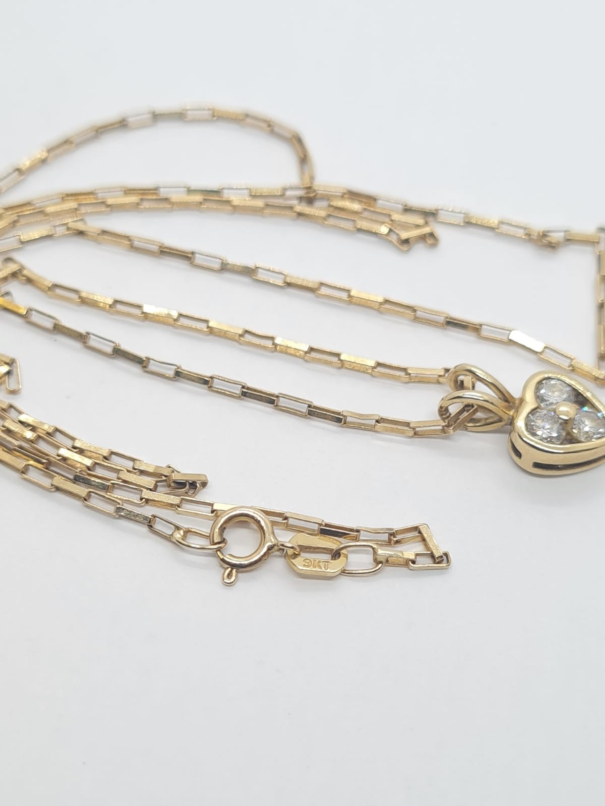 9k Yellow gold DIAMOND SET HEART PENDANDT ON A 52cm long linked box CHAIN, weight 2.5G and approx - Image 2 of 3