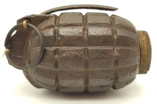 INERT No 5 Mills Hand Grenade in good condition. A few pits around the filler screw caused by the