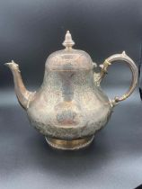 Large antique silver teapot covered in fabulous intricate chase work having clear hallmark for