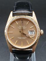 18k yellow gold gents watch with rose gold face and black leather strap. 36mm