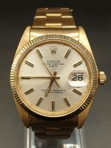 Rolex Oyster Perpetual Date watch 18k yellow gold face and solid gold strap, 34mm