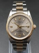 Rolex Oyster Perpetual unisex watch, two-tone colours silver face. 32mm