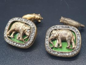 A PAIR OF SILVER WITH ENAMEL AND DIAMOND RUSSIAN CUFFLINKS DEPICTING AN ELEPHANT AND BEAR