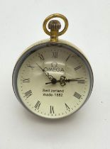 A VINTAGE OMEGA GLASS GLOBE TABLE CLOCK WITH ROMAN NUMERALS AND SECOND HAND, FWO. 363gms 6cms