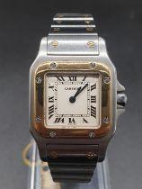 Santos de Cartier Oretacier watch, square face Roman numerals and two-tone (bi-metal) strap