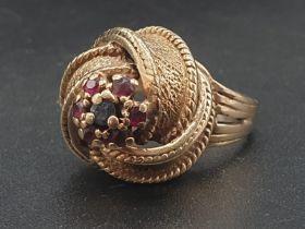 14K Yellow Gold Fancy twist Garent set ring. Weighs 7g. Size K.