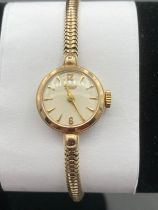 Vintage solid gold ladies TISSOT cocktail wristwatch. 9 carat gold fully hallmarked . 14.9 grams.
