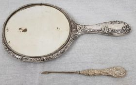 A White-Metal Antique Hand Mirror and Manicure. Beautiful Ornate design. Slight damage to the